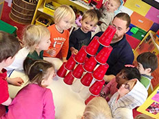 2-Year-Old Room - Kids playing with cups