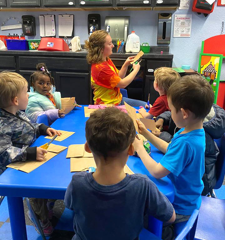 Children crafting with teacher at Robin's Nest Learning Center in Carbondale, Illinois