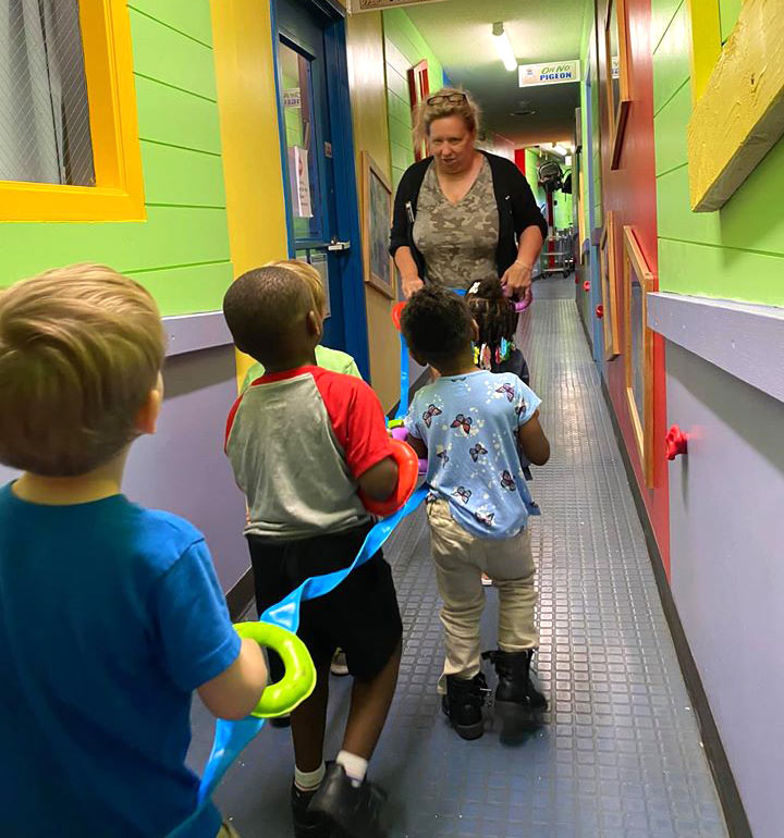 Children walking down the hall at Robin's Nest Learning Center in Carbondale, Illinois