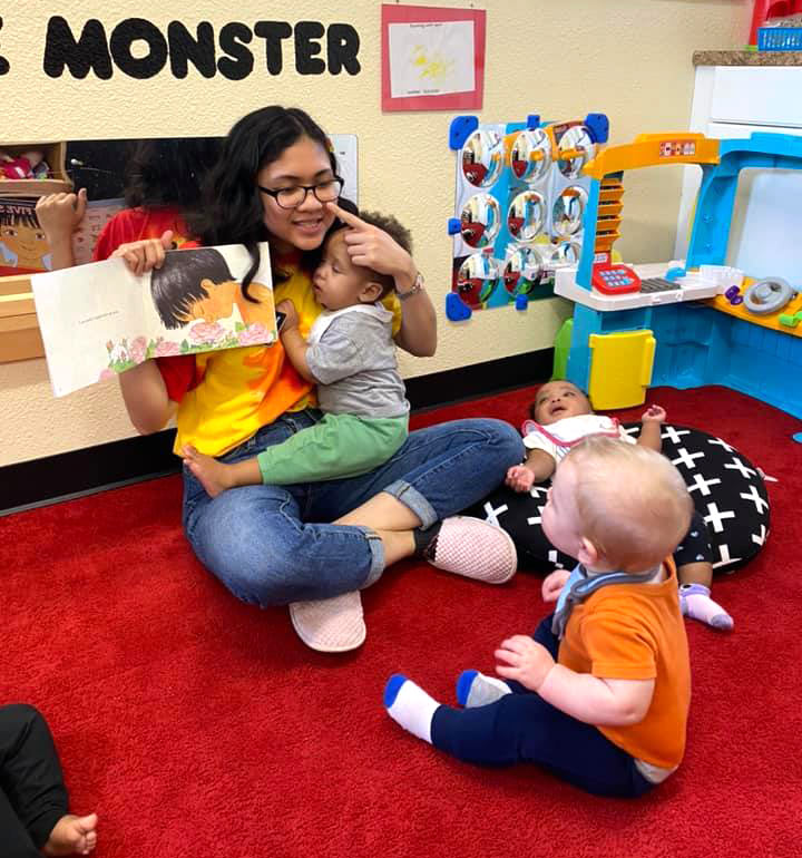 Teacher reading to todlers at Robin's Nest Learning Center in Carbondale, Illinois
