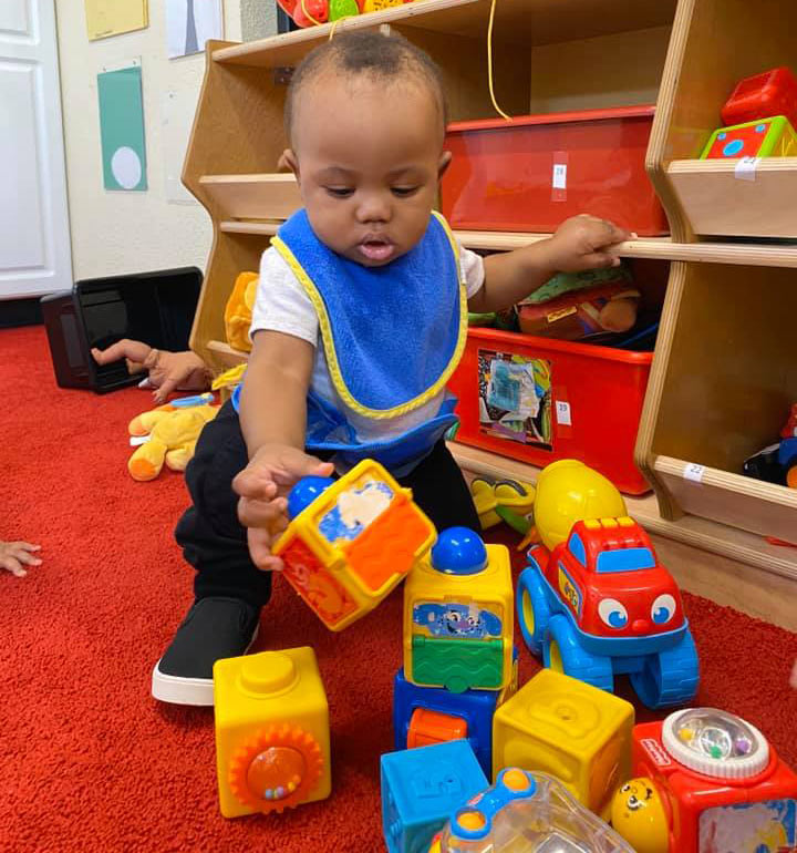 Infant playing with blocks at Robin's Nest Learning Center in Carbondale, Illinois