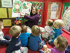 Toddlers Room - Teacher reading to kids